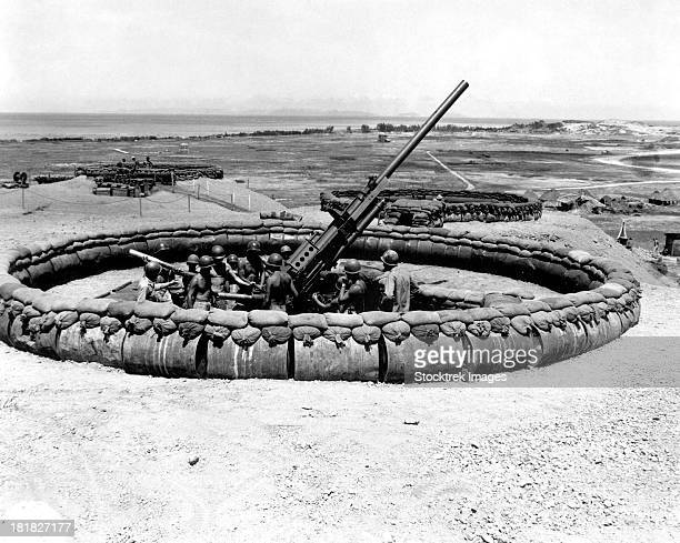 july 18, 1945 - view of a 90mm aaa gun emplacement with crew in pit, okinawa, japan. - anti aircraft stock photos and pictures