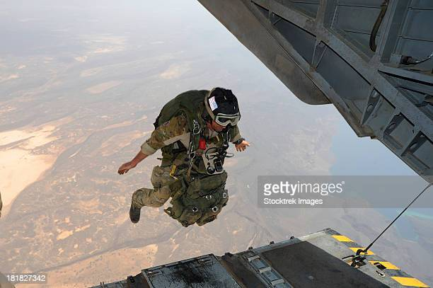 July 18, 2012 - A U.S. Air Force pararescueman jumps from a Marine Corps CH-53E Super Stallion helicopter over the Grand Bara Desert, Djibouti.