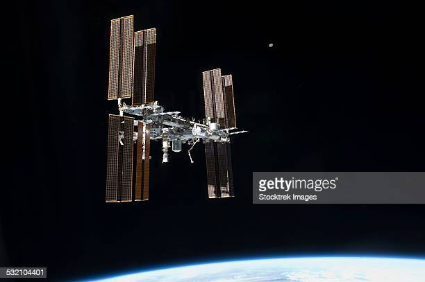 july 19, 2011 - the international space station in orbit above earth. - international space station fotografías e imágenes de stock
