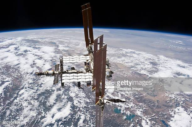 July 19, 2011 - The International Space Station in orbit above Earth.