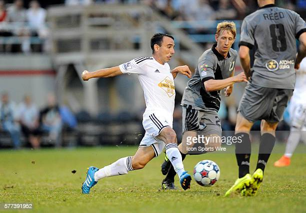 Swansea City AFC Swans midfielder Leon Britton passes the ball in front of Minnesota United Loons defender Greg Jordan during an international club...