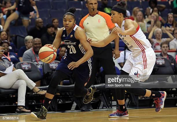 Natasha Cloud of the Washington Mystics moves towards Alex Bentley of the Connecticut Sun during a WNBA game at Verizon Center in Washington DC...