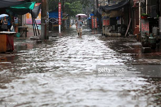 XINGTAI July 19 2016 Residents walk on a flooded road in Xingtai north China's Hebei Province July 19 2016 Heavy rain afflicted some regions of north...