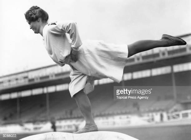 A Danish woman gymnast exercising at the 1908 London Olympics