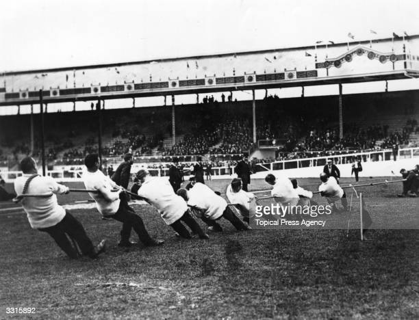 Great Britain taking on Ireland in the tugofwar event at the 1908 London Olympics The Liverpool St Police tugofwar team beat the USA team and won the...