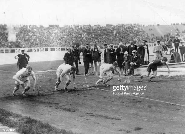 Reggie Walker in lane one on the right at the start of the 100 metres final in the 1908 Olympiad in London Walker won with a world record equalling...