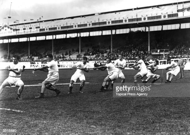 The Unites States tugofwar team in action during the 1908 London Olympics at White City Stadium