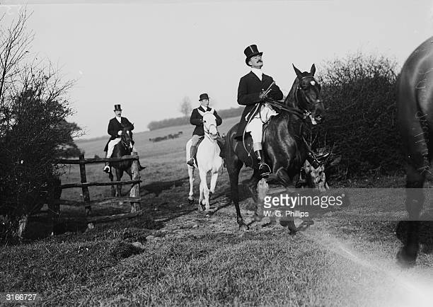 Members of British high society enjoy the hunt through the English countryside.