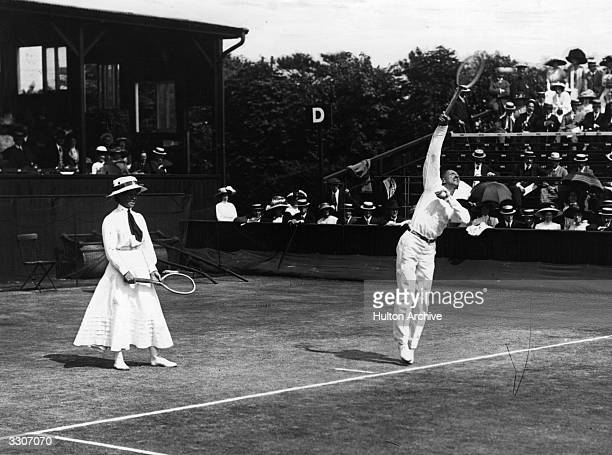 M Cobes and J B Ward in action during a mixed doubles match at the Wimbledon Lawn Tennis Championships