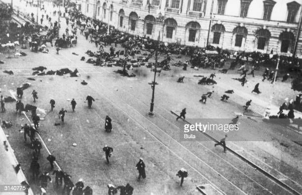 Crowds flee from street fighting between Leninists and troops loyal to the the Kerensky provisional government outside the Duma on the corner of...