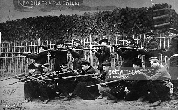 Two rows of Red Guards train at a firing range after the July Days Petrograd Russia On July 3rd and 4th 1917 workers and soldiers demanded the Soviet...