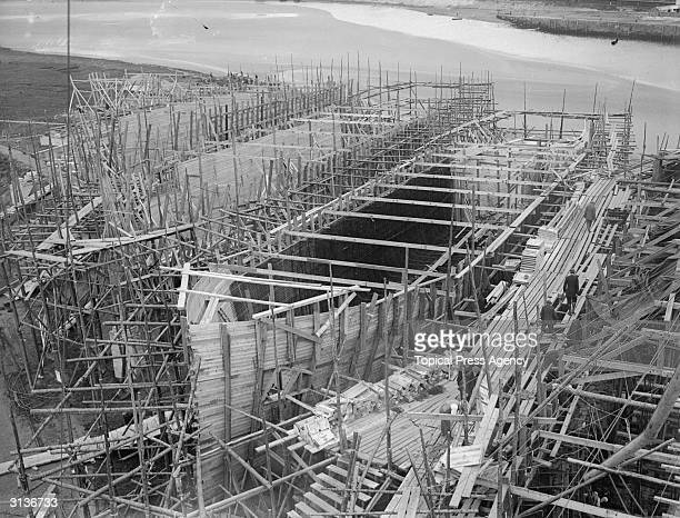 Scaffolding and wooden casing in position when building a concrete ship