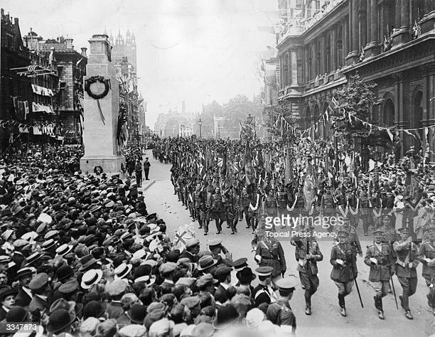 British soldiers passing the Cenotaph as they parade in the London Peace Pageant after WW I.