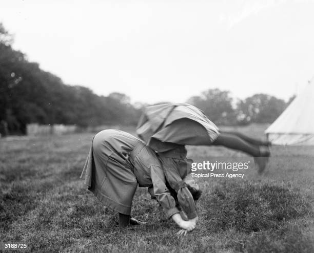 Two members of the Women's Army Auxiliary Corps practice their somersaults during a sports day in Woolwich London