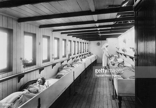 Nurse tends to young patients in a river ambulance for sufferers from infectious diseases such as tuberculosis . The ambulance belongs to the London...