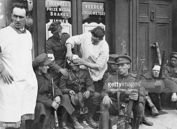Doctors attending to wounded soldiers after the Battle of Dublin during the Irish Civil War