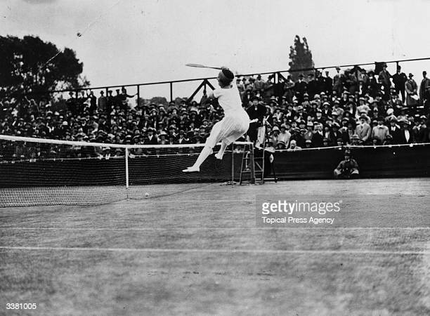 French tennis player Suzanne Lenglen competing in the women's singles tournament at Wimbledon which she went on to win.