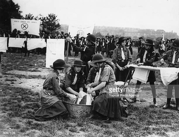 Girl Guides take part in a laundry competition at Finsbury Park in London