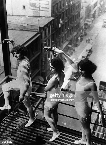 Pearl Eaton Marie Wallace and Leonore Baron model allinone suspenders on a high scaffolding platform