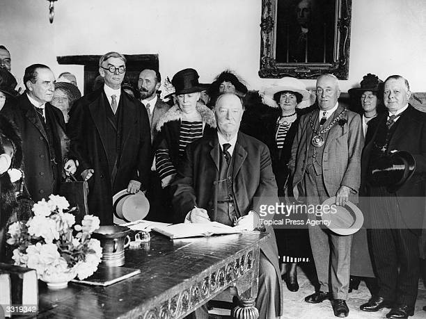 The Chief Justice of the Supreme Court and former President of the United States of America William Howard Taft signing the visitors' book at...