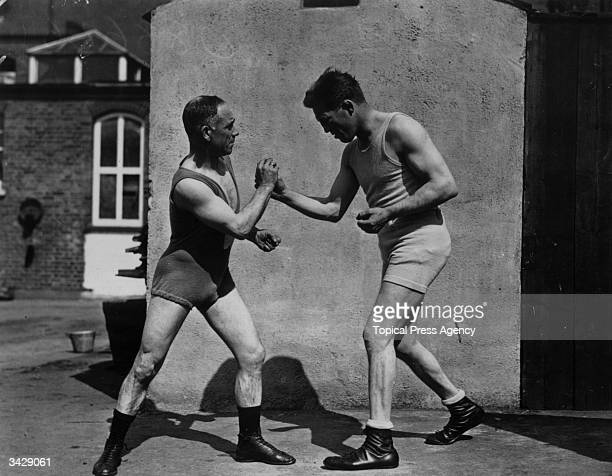 Highlty successful welter and middleweight champion boxer, Ted 'Kid' Lewis spars with Thomas 'Pedlar' Palmer at Shoeburyness, Essex.