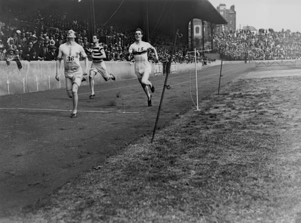 Scottish athlete and missionary Eric Henry Liddell winning the 220 yards race at the Amateur Athletics Association championships at Stamford Bridge...