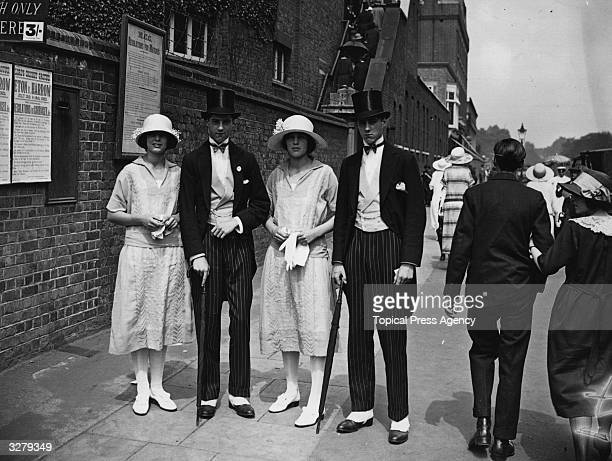 Two pairs of twins Edward and George Ward and Miss Mell and Miss Ward at Lord's to see Eton play cricket against Harrow