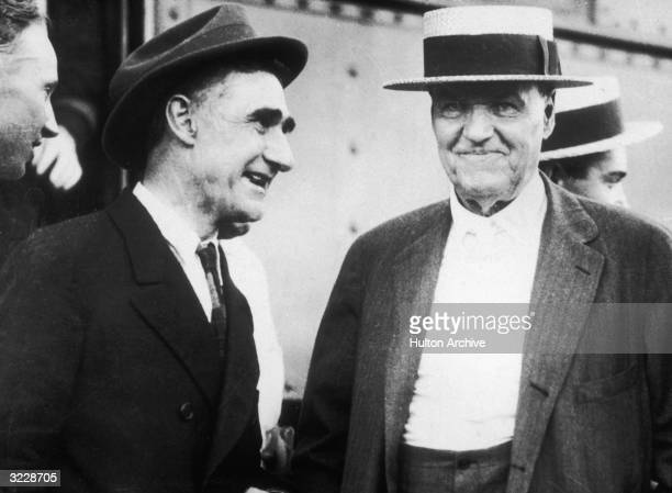 An unidentified man standing with attorney Clarence Darrow at the time of the Scopes Monkey Trial in which Darrow was defending Tennessee high school...