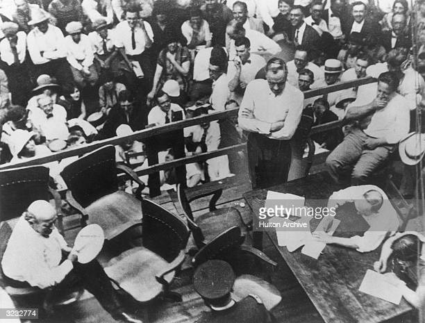 Highangle view of Clarence Darrow defence lawyer questioning William Jennings Bryan director of the prosecution about the Bible during the Scopes...