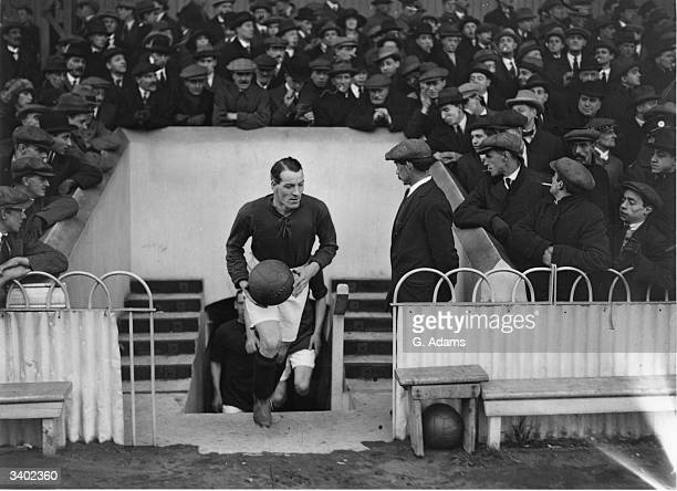 Longworth leads the Liverpool Football Club team out onto the pitch.