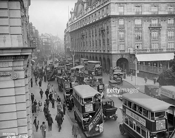 Buses In Piccadilly near the Ritz Hotel London