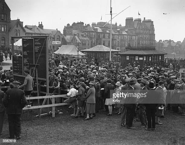 The scoreboard at St Andrews golf course in Scotland, causing much interest during a British Open Golf Championship. The Royal and Ancient golf club...