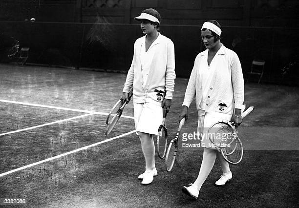 American tennis players Helen Wills and Helen Jacobs walking onto the court before their women's singles final at the Wimbledon Lawn Tennis...