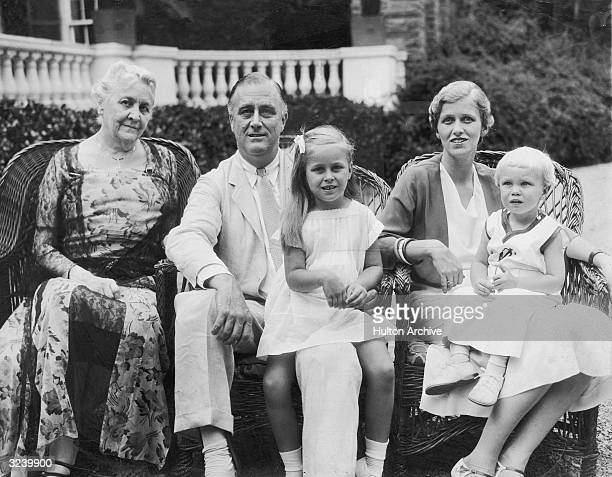 Group portrait of New York State Governor Franklin Delano Roosevelt with his mother Sara his granddaughter Ann Roosevelt Dall his daughter Anna Dall...