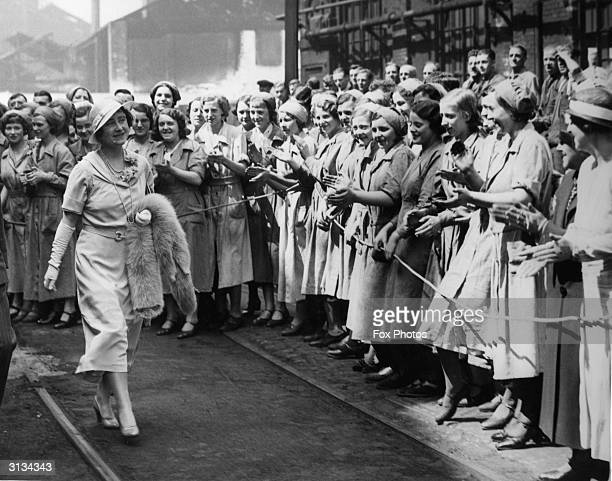 Elizabeth, Duchess of York, later the Queen Mother receives an enthusiastic welcome from a crowd of female workers during a visit to the Firth &...
