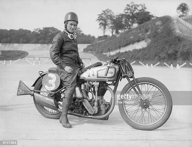 Miss Beatrice Shilling sits astride her Norton motorcycle at the Brooklands race track.