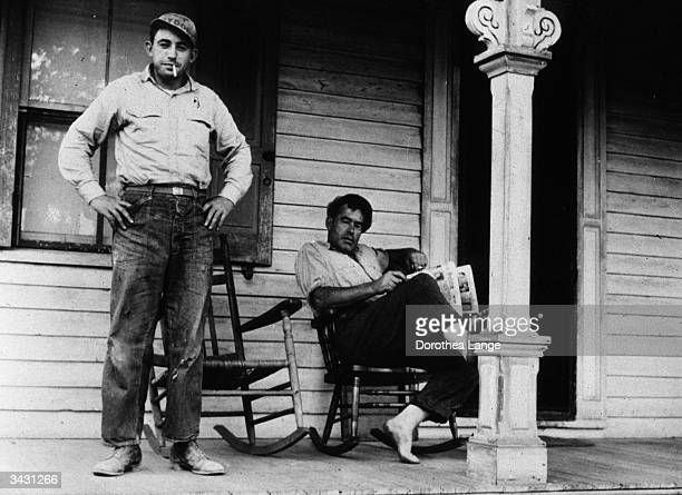 A father and son on the porch of a house near Bridgeton New Jersey