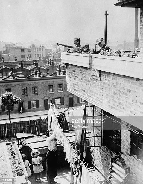 Bethnal Green and East London Housing Association flats at Brunswick Street Hackney Deep balconies are set back from those of the floor below forming...