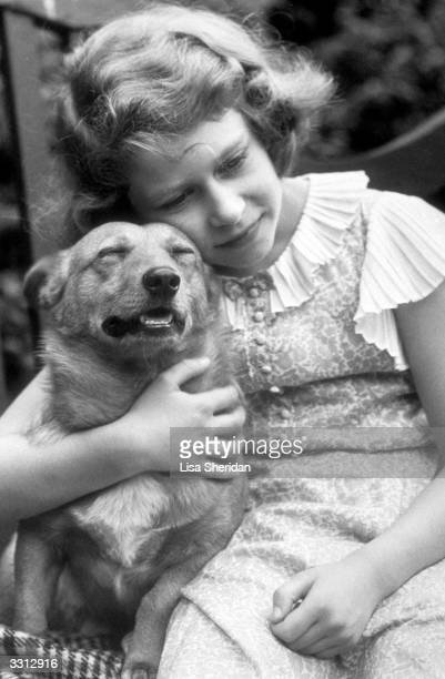 Princess Elizabeth hugging a corgi dog