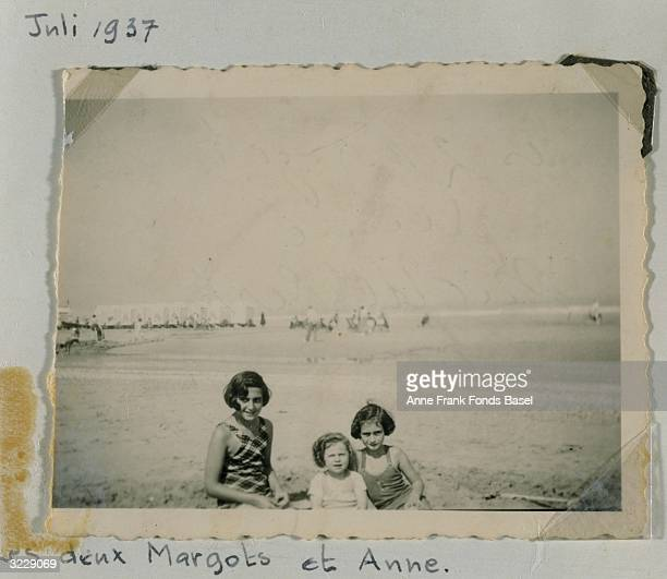 EXCLUSIVE Portrait of Margot and Anne Frank on the beach with an unidentified younger girl taken from Anne Frank's photo album Middelkerke Belgium