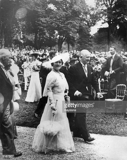 Queen Elizabeth walking with the French President Albert LeBrun during a garden party at Bagatelle in honour of the royal visit to Paris