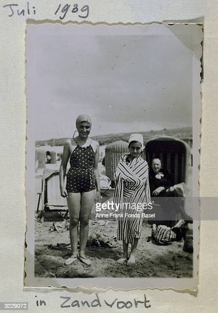 EXCLUSIVE Fulllength portrait of Margot and Anne Frank on a beach with their grandmother in the background taken from Anne's photo album Zandvoort