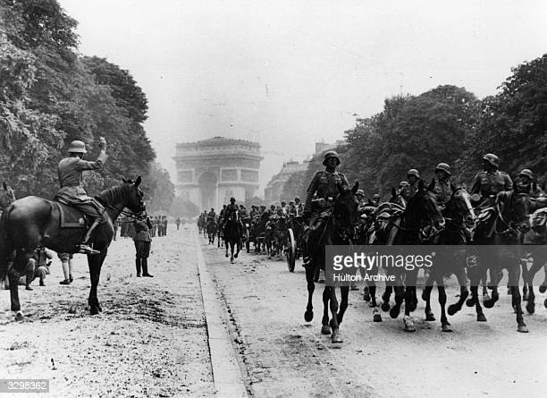 German artillery march down the Champs Elysees from the Arc de Triomphe, in Paris after taking the city.