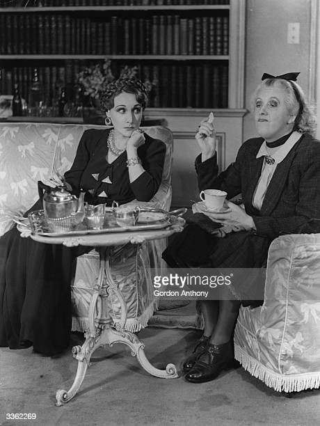 Fay Compton as Ruth and Margaret Rutherford as medium Madame Arcati in the Noel Coward play 'Blithe Spirit' at the Piccadilly Theatre, London.