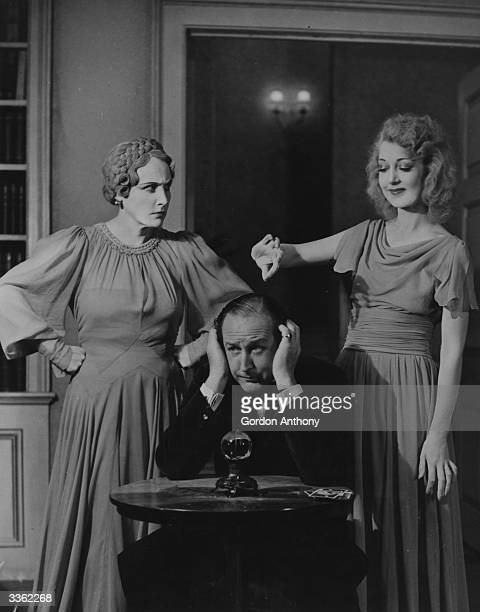 Fay Compton as Ruth Cecil Parker as Charles and Kay Hammond as Elvira in the Noel Coward play 'Blithe Spirit' at the Piccadilly Theatre London