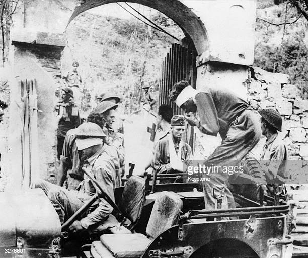 British and German troops both injured in the fierce fighting around Salerno Italy during the early days of the Italian campaign arrive at a first...