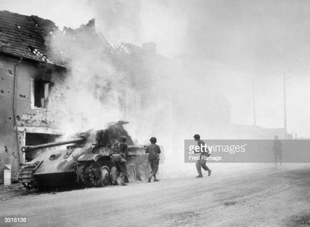 A German Panther tank falls prey to American troops in Perriers Normandy