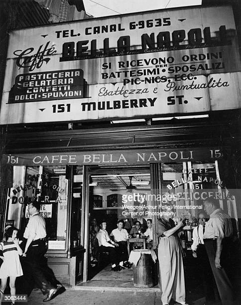 Friends gather to talk at the Caffe Bella Napoli on Mulberry Street Little Italy the Italian community of New York City Photo by Weegee/International...
