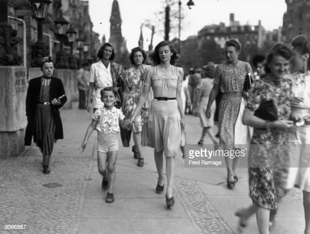 Materials looted from European countries provide clothing for German women who are well dressed compared to women from other countries at the end of...