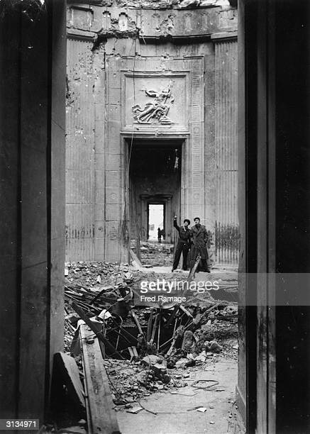 The ruined interior of the Chancellery in Berlin after World War II showing the path of an American bomb which landed in the vicinity of Hitler's...